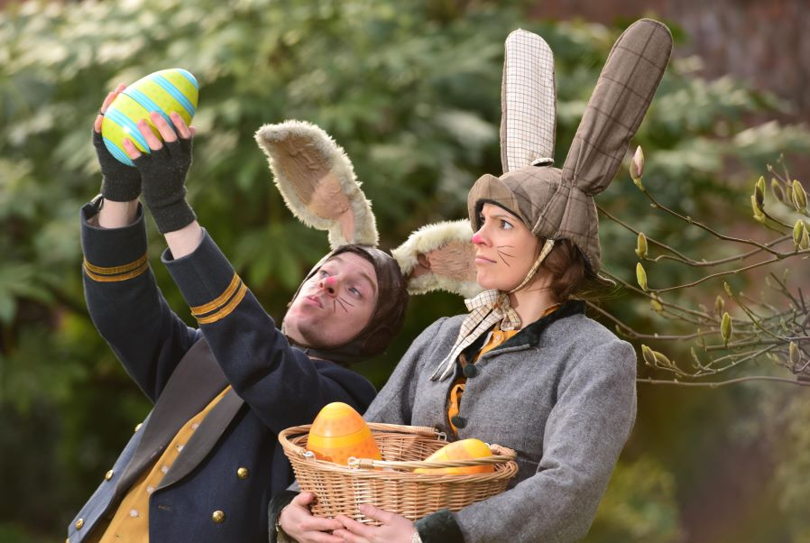 Two people dressed as Easter Bunnies for the Egg Hund at York's Chocolate Story