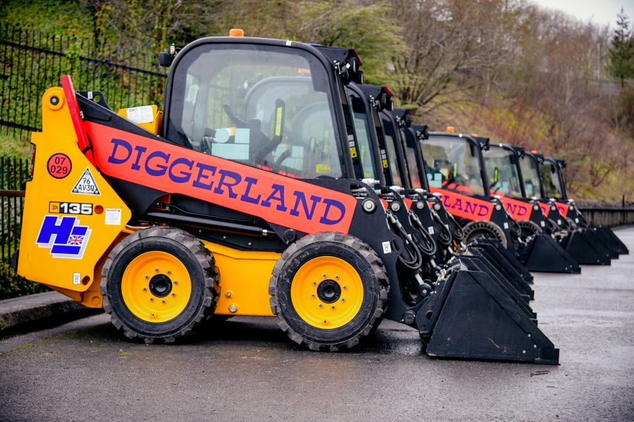 Line of JCBs at diggerland