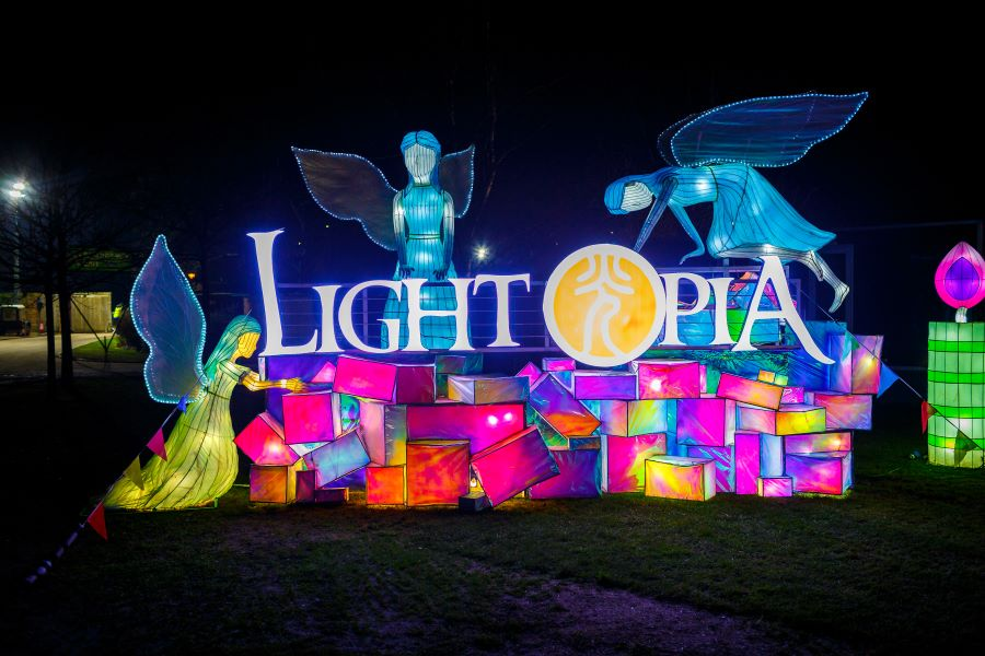 "Lantern sculpture at Yorkshire Wildlife Park's Winter Illuminations depicting fairies stacking a pile of presents and the words ""Lightopia"""