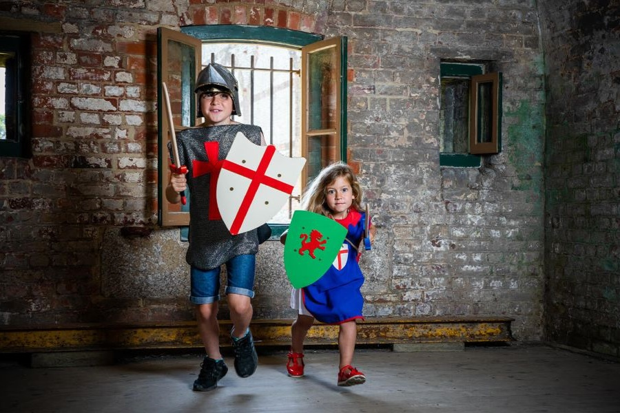Children dressed up as knights with swords and shields at Royal Armouries Museum