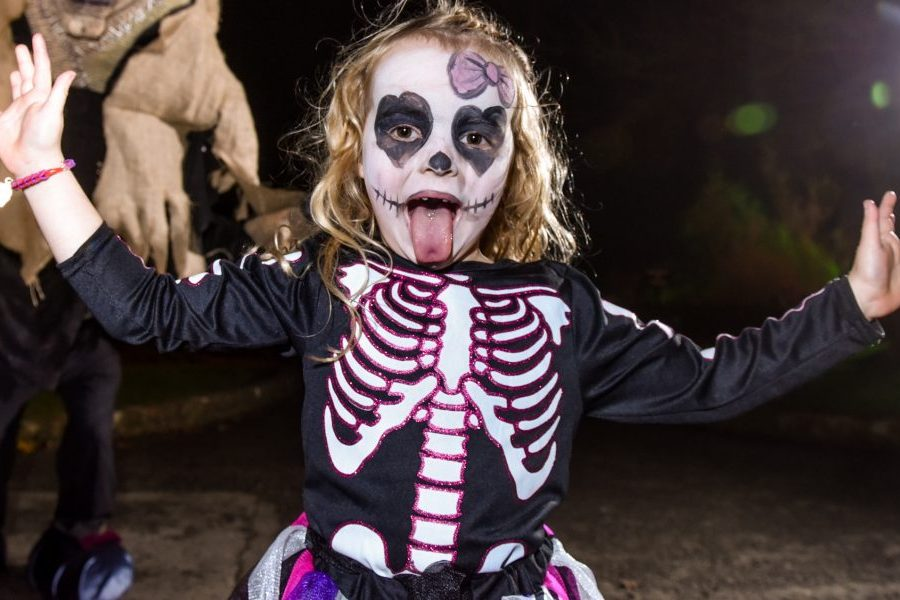 Little girl in skeleton costume during Halloween at Lightwater Valley