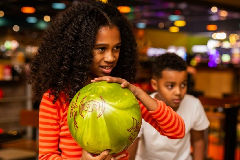 boy and girl bowling at exscape