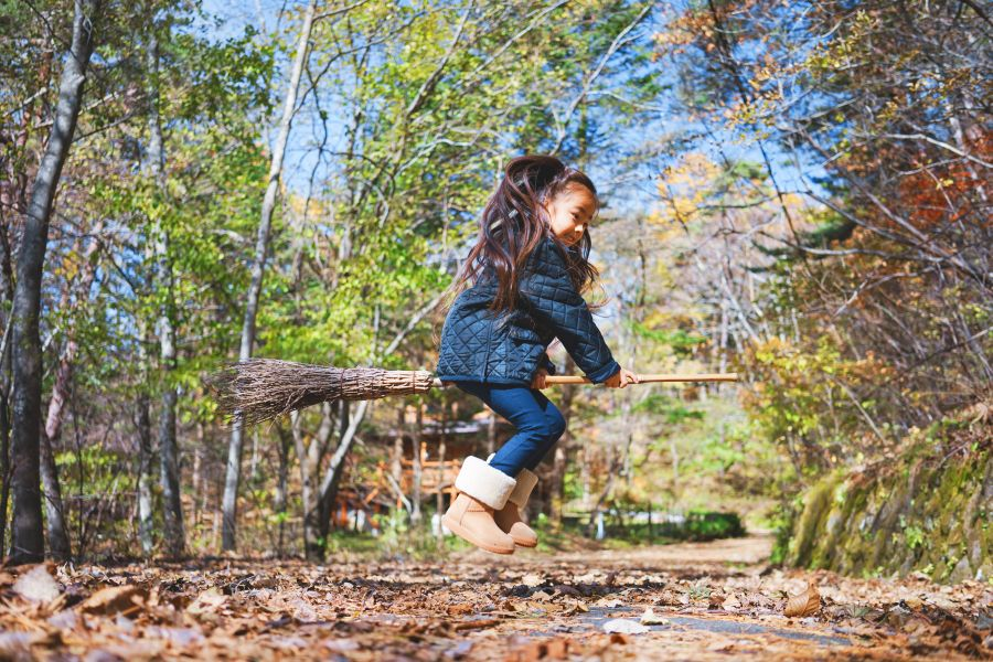 Little girl on a broomstick at williams den