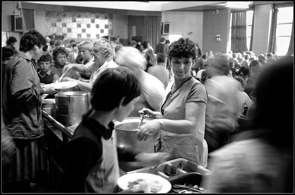 Black and white photo of women cooking and serving food to people during the Miner's Strike by Keith Pattison